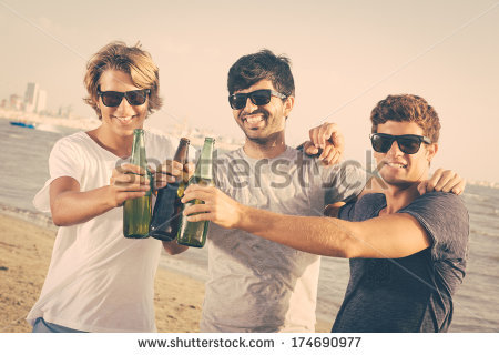 stock-photo-group-of-boys-cheering-at-beach-174690977