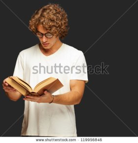 stock-photo-portrait-of-a-man-reading-a-book-isolated-on-black-background-119956846