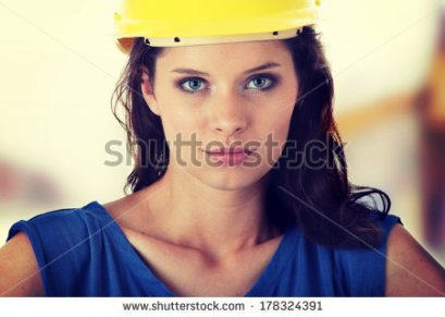 stock-photo-young-female-architect-or-builder-wearing-a-yellow-hart-hat-on-a-construction-site-178324391