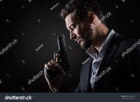 stock-photo-brave-cool-man-holding-a-gun-on-dark-background-248868652